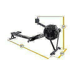 Commercial chain driven air resistance rower with damper