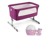 Purple Next2Me Crib with projector