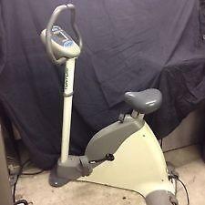 Tunturi exercise bike and gym equipment.
