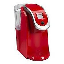 Bright red..Keurig  2.0.. Like new -plus knows and carasol