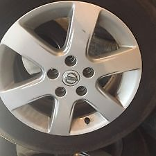 Selling 4 Rims with Michelin HydroEdge tires.