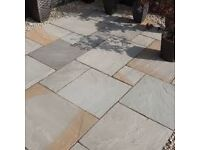 A SELECTION OF CALIBRATED NATURAL INDIAN SANDSTONE PATIO PAVING PACKS (UNOPENED)