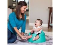 BUMBO child safety feeding chair sits on kitchen chair