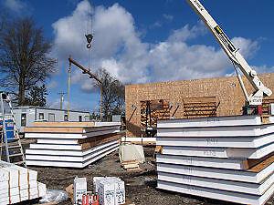insulated structural panels.  wood/foam/wood or steel/foam/steel