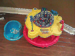 Evenflo Exersaucer and toys.