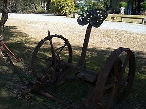 Old farm relics, ploughs, steel wheels, cast iron seperators etc