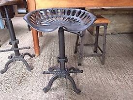 New cast iron tractor seat / stool with a foot rest