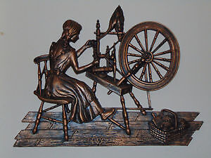 Large coppercraft guild of woman spinning wool