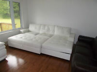 BRAND NEW.  ALL LEATHER SECTIONAL WITH CHAISE LOUNGE AND OVERSIZ