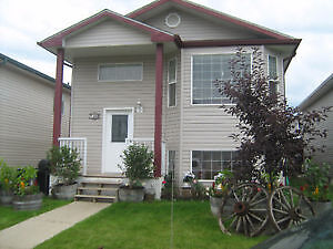 Furnished bedroom located in bi-level house in Timberlea