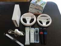 Nintendo Wii & all accesories & 8 games