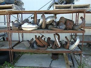 Miss snowmobile parts including skis, trailing arms, exhaust pip