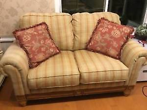 Country Plaid Sofa with Pine Accent Trim in good condition.
