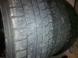 205/60R16 snow tires on black steel rims, 5 bolt.