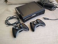 Immaculate condition xbox 360 elite black hardly used at all 6games 2 pads