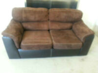 brown microfiber and black faux leather loveseat delivery includ