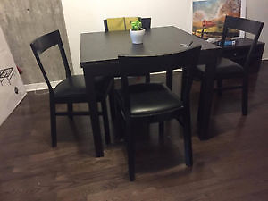 Bjurista dining table from IKEA with 4 leather chairs