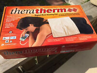 TheraTherm BRAND NEW heating pad! $100 value.. $50 or best offer
