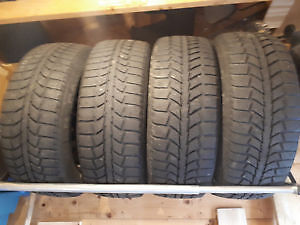 4 Uniroyal Tiger Paw Winter Tires on Steel Rims