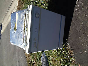 White Dishwasher and Coil Electric Stove