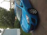 2010 Mazda3 hatchback sky blue fun to drive and great on gas.