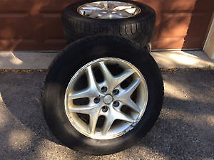 Four Michelin X-ICE 215 60 r16 tires with rims,