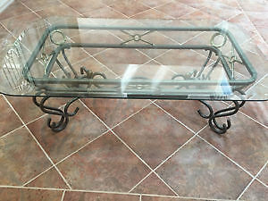 Wrought iron and glass-topped coffee table and two end tables