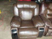 Brown leather recliner with storage for sale.