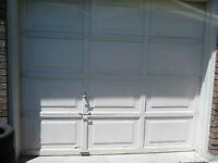 8'x7' standard garage door / acc / key / new spring $200.00.