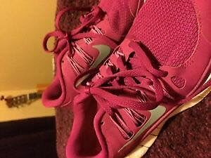 Pink Nikes worn only once