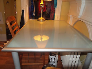 Spacious worktable/desk with elegant opaque glass surface