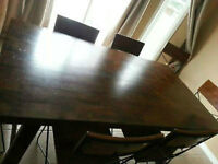 Solid Wood and wrought iron dining table and 8 chairs.
