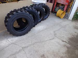 tire or rim NEW 10-16.5$130.  12-16.5 $150.for bobcat skid steer