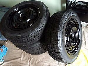 235/70R16 Michelin X-Ice on steel wheels for Ford Escape. $124.95 each (85% tread)