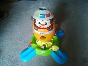 Bright starts hide & spin monkey sit or stand play toy