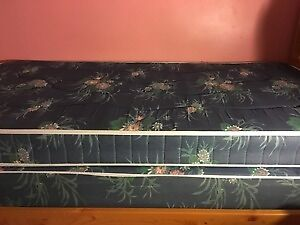 Single bed with mattress and box spring