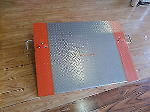 DOCK PLATES AND DOCK BOARDS NEW AND USED