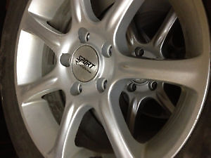 Used winter 215/55 R16 tires with rims