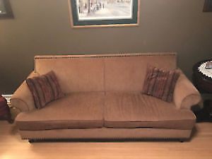 Modern Beige couch, nail head detailing