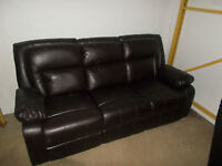 BRAND NEW.  BROWN LEATHER RECLINING SOFA
