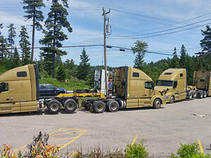 Towing and drive-away services all trucks available  Can/U.S.A