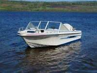 looking to trade 16 foot bowrider,motor and trailer