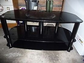 Black and chrome glass TV table