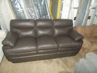 BRAND NEW.  BROWN LEATHER SOFA