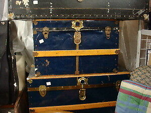 Trunks, vintage suitcases and wood crates