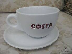 Costa Coffee cups and offset saucers with bean logo , new .