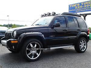 looking to buy 2004 Jeep Compass black Hatchback