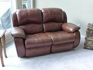 Reclining leather sofa
