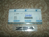 """NEW GM REAR END PANEL AND TAILGATE""""Z34"""" PLATE OEM 10189887"""
