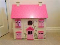 Pink asda dolls house with people and furniture